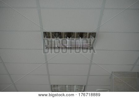the construction of the ceiling, broken Ceiling light built-in white ceiling close-up diagonal view