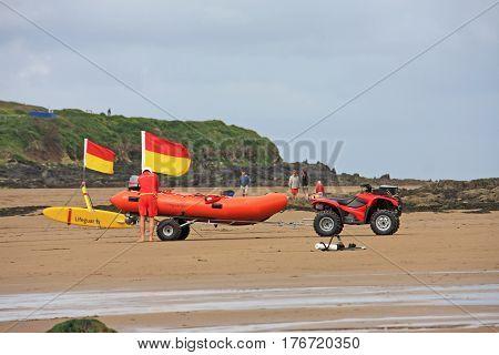 lifeboat standing on Bigbury beach in Devon
