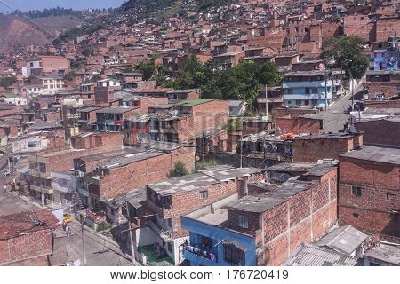 Cityscape of Medellin city in Antioquia region Colombia. Shanties built on the slopes of the mountains. Homes townships.