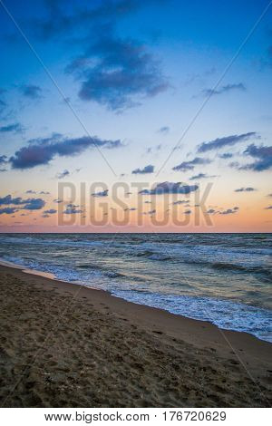 Pamorama of beautiful seascape. Nature composition. Evening sky with contrast colour clouds