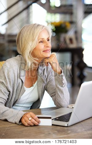 Attractive Older Woman With Laptop Computer And Credit Card
