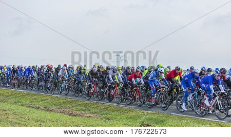 Le Gaut Saint DenisFrance- March 72016: The peloton riding in Eure et Loire region of France during the first stage of Paris-Nice 2016.