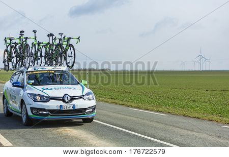 Le Gaut Saint DenisFrance- March 72016: The technical car of the Australian cycling team Orica GreenEDGE driving in Eure et Loire region of France during the first stage of Paris-Nice 2016.