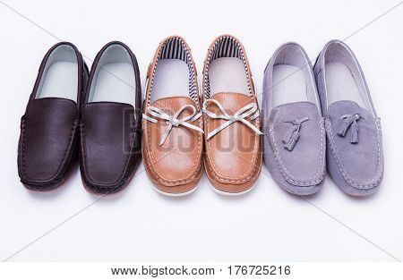 Different moccasins for a boy from different materials on a white isolated background