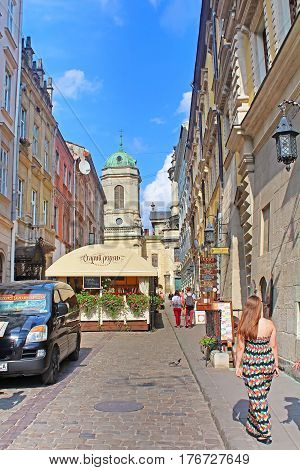LVIV, UKRAINE - JULY 17, 2015: Stavropihiyska street in Lviv and tower of Dominican Cathedral