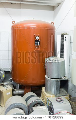 orange expansion tank in the boiler room