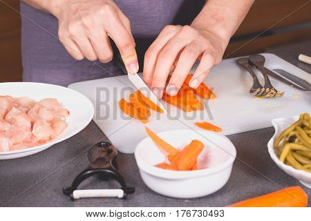 Cook Cutting Carrots With A Ceramic Knife