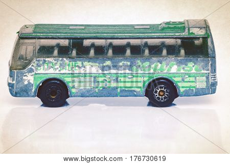 small old metal toy bus