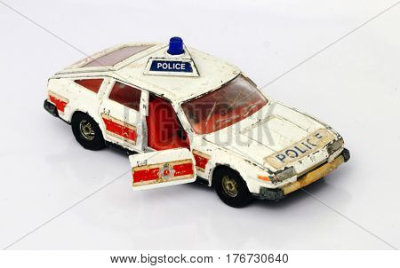 old  toy police car on white