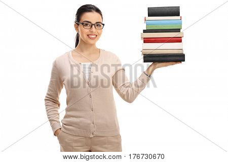 Young female teacher with a stack of books isolated on white background
