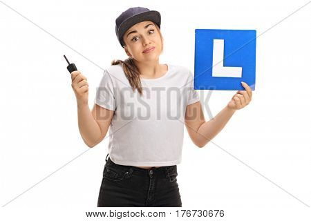 Confused teen girl holding a car key and an l-sign