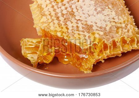 The honey comb in a ceramic dish