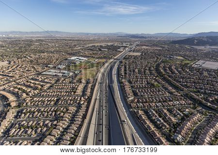 Aerial view of desert suburban sprawl along the 215 freeway in the Summerlin area of Las Vegas, Nevada.