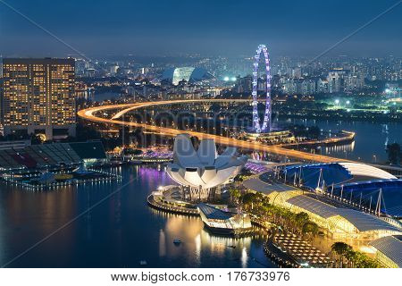 Singapore business district skyline in night at Marina Bay Singapore.