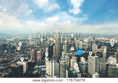 Searching location on map and pin above Kuala Lumpur city and network connection internet of things satellite navigation system concept