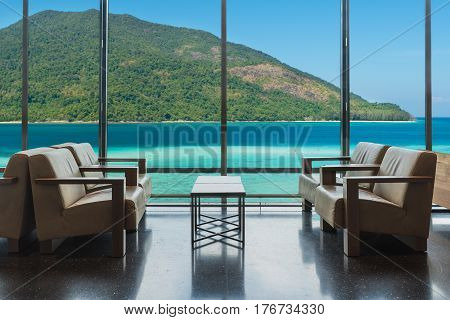 Luxury hotel lounge with windows overlooking sea in Phuket Thailand. Summer Travel Vacation and holiday concept.