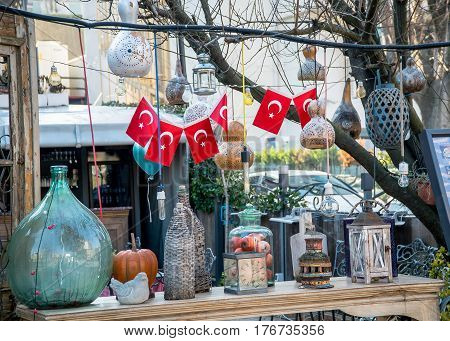 Istanbul, Turkey - February 18, 2017: An assortment of antic lanterns with Turkish flags displayed in Eminonu district