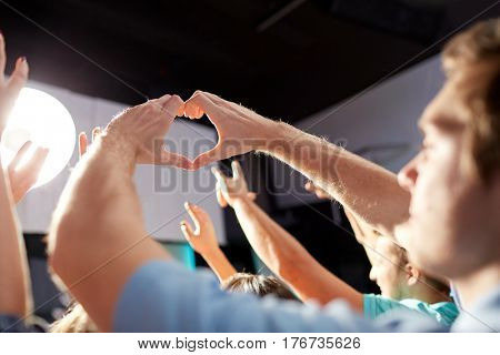 party, nightlife and gesture concept - group of people at concert in club