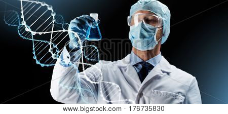 science, chemistry, research and people concept - young scientist in protective mask, hat and goggles holding test flask with chemical over dark background and dna molecule