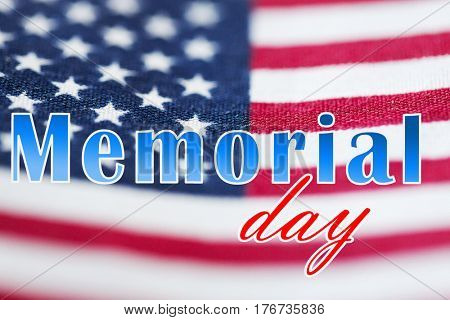 patriotism and national holidays concept - memorial day words over american flag