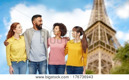 travel, tourism, diversity and people concept - international group of happy smiling men and women over eiffel tower background