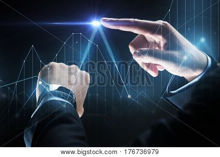 business, people and technology concept - close up of businessman hands with smartwatch and diagram chart virtual projection over black background