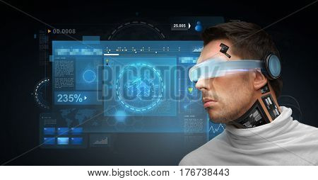 people, technology, future and progress - man with 3d glasses and microchip implant or sensors with virtual screens over dark background