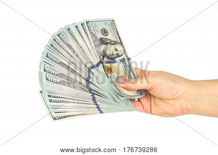 Female hand hold a lot of US 100 dollars banknotes isolated on a white background