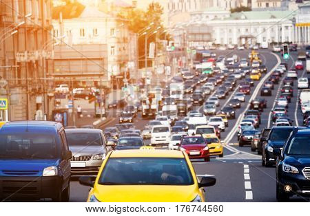 Heavy traffic on the city highway with yellow car on the front