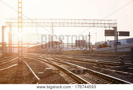 Railway junctions with switch and station on the background