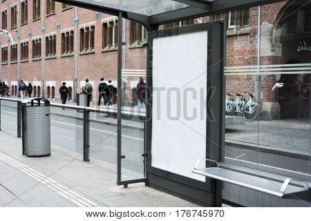 Outdoor bus stop advertising mockup with blank poster screen