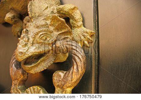 Metal Knocker Shaped Dragon. Spanish Colonial Style Door. Cartagena De Indias, Colombia.