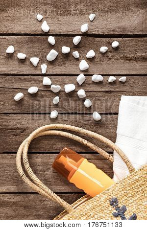Top View Of Beach Bag With Sunscreen, Towel And Sun Symbol From White Stones, Summer Concept