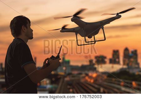 Silhouette Of A Man Controlling Flying Drone. 3D Rendered Illust