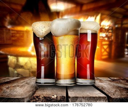 Three glasses of beer on a table in bar