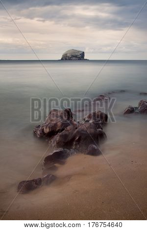 The Bass Rock is a distinctive island in the Firth of Forth, East Lothian, Scotland which has variously served as a hermitage for early Christians and a Covenanter prison in the 17th century. It is currently home to the largest colony of gannets in the wo