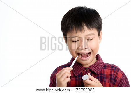 Dentist Checking Young Asian Boy Teeth