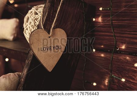 Wooden heart with the word love you on old wooden ladder