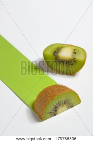 Kiwi fruit sliced and green path on white background