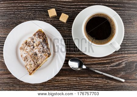 Black Coffee, Lumpy Sugar And Piece Of Cake In Plate