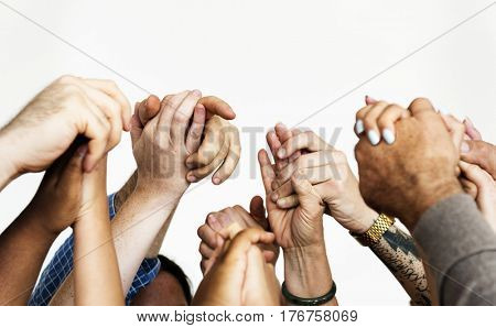 Group of people holding hands support together