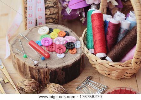 Sewing accessories for sewing on wood background
