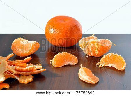Orange seet lobules of mandarin on the table