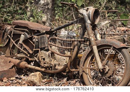 Old abandoned partially dismantled retro motorcycle on the street