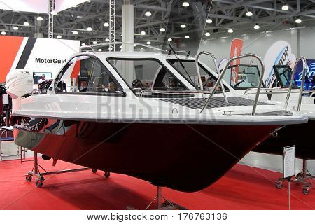 MOSCOW - MARCH 09 2017: Boat Phoenix 530 HT for 10 International boat show in Moscow. Russia.