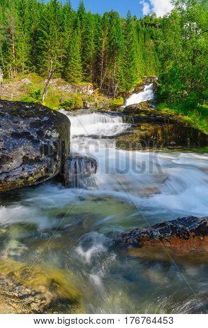 Waterfall in wilderness woodland area long exposure