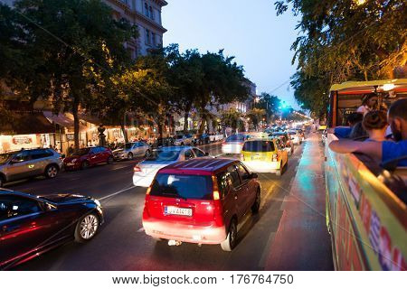 BUDAPESHT, HUNGARY- JULY 06: photo of night Budapest street in motion from sightseeing bus on july 06, 2015 in Hungary