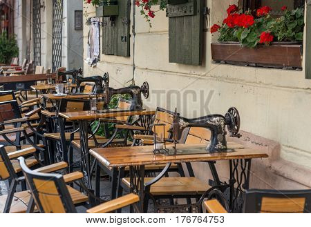 POLAND, KRAKOW- JULY 02: Small caffee in the centre tiny wooden tables and chairs in Krakow Poland on July 02, 2015