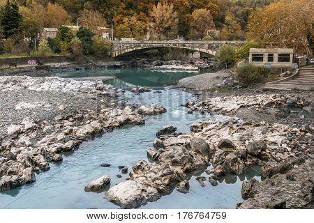 KUTAISI, GEORGIA, NOVEMBER, 05: Rough waters of the local georgian mountain river in Kutaisi, bunch or rocks around on nowember, 05, 2016 in Georgia