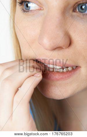 Close Up Of Nervous Woman Biting Nails
